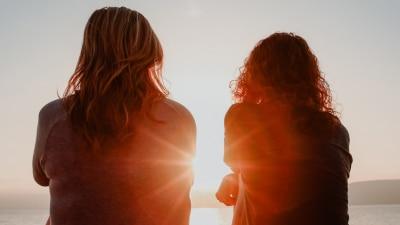 Two women watching sunset